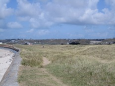 Seawall and expansive back-beach at St Ouen's Bay, Jersey (view north).