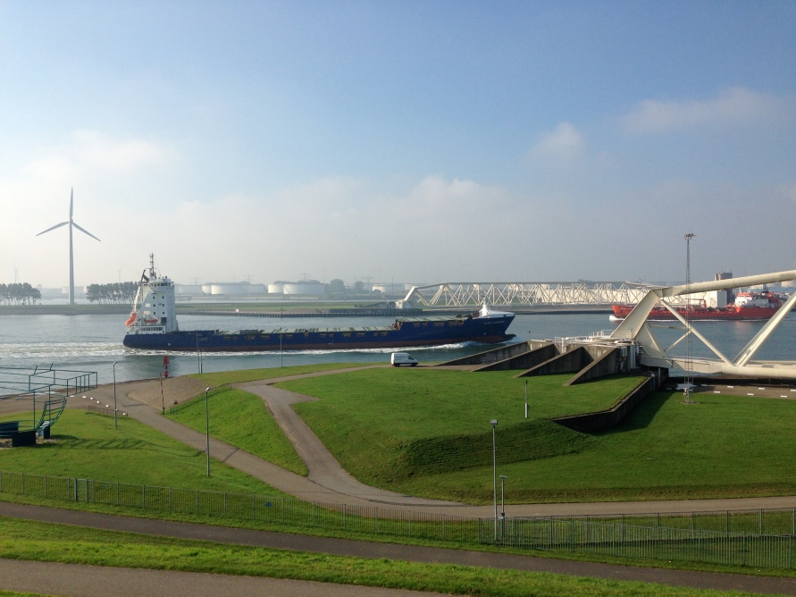 Two tankers passing the Maeslant installation – one leaving the port of Rotterdam (blue hull), one entering (red).