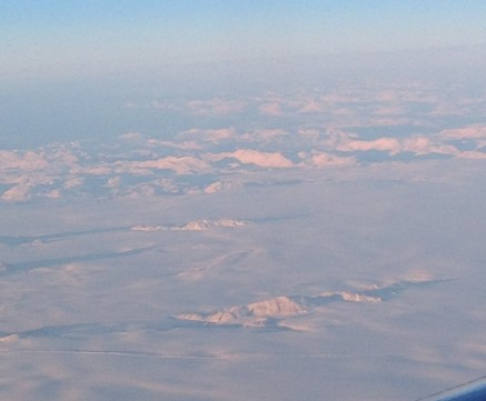 Visible drag line in the ice & snow trailing from pinnacle just piercing the surface. (Southern Greenland, west coast.)